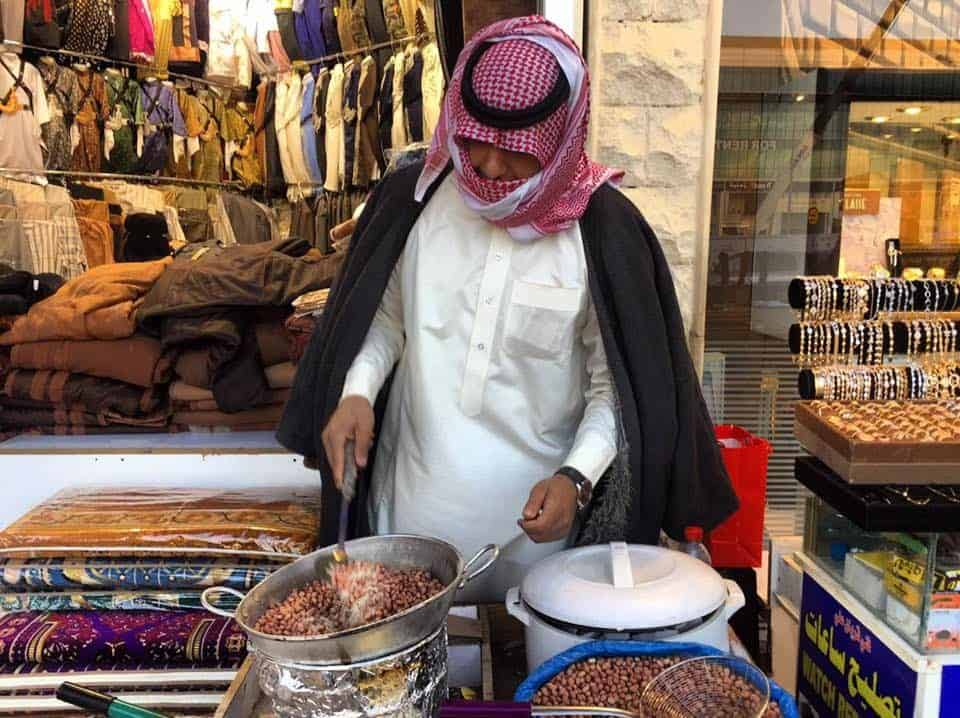 At the market on a Friday morning, cooking peanuts in Riyadh.