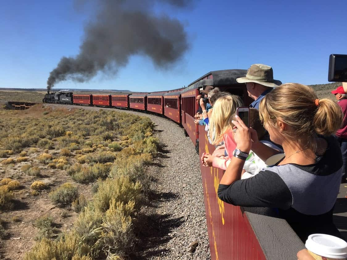 The Cumbres & Toltec steaming out of Antonito, Colorado towards Hangman's Bridge, where local tales have it that an outlaw was once hanged.