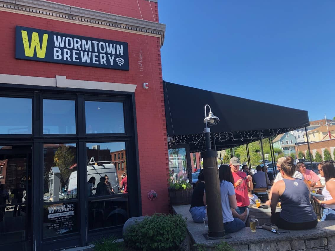 The outdoor beer garden of Wormtown Brewery is a great place to relax with a local brew.