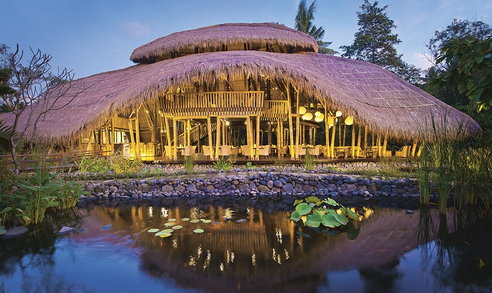 Sakti Dining Room at Fivelements Healing Center, a vegetarian hotel. The soaring roofline, sculpted from bamboo and thatch, resembles a banana leaf, symbol of nourishment. Banjar Baturning, Bali Photo © Djuna Ivereigh
