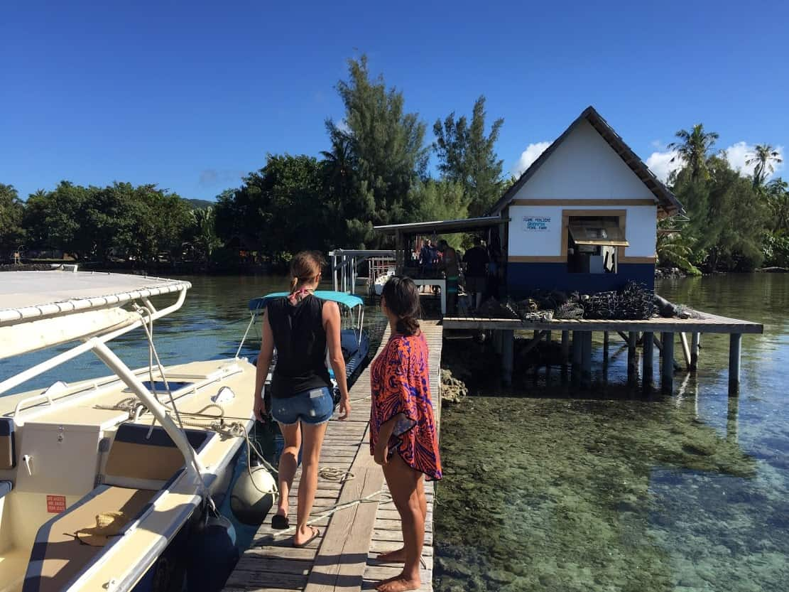 Michelle entering Champon Pearl Farm on the island of Taha'a.
