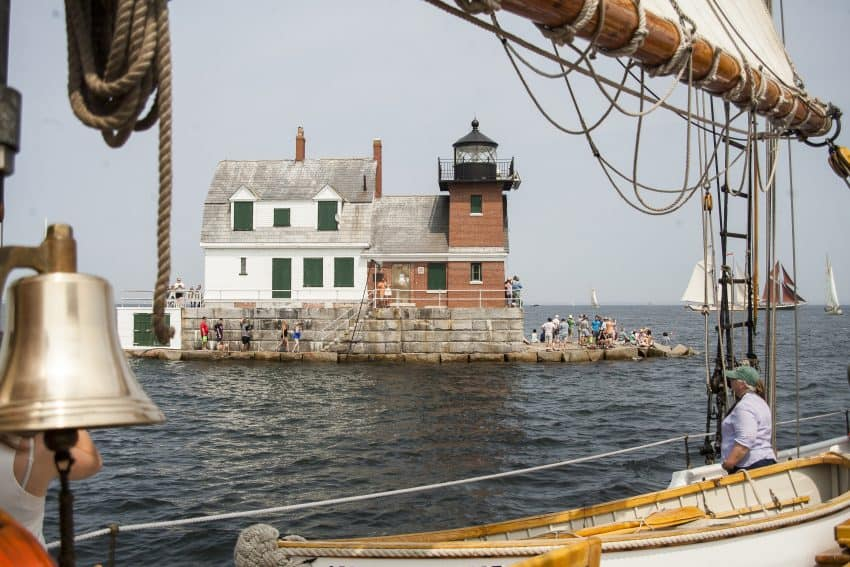 A crowd cheers the schooners on at the Rockland Breakwater Lighthouse, Rockland Maine.