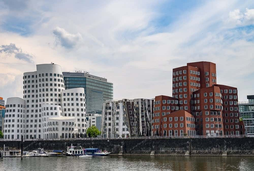 The Neuer Zollhof buildings are the creation of architect Frank Gehry and can be found in the Media Harbor area of Dusseldorf.