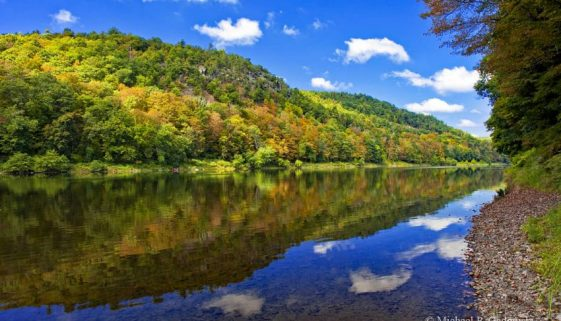 Pow Wow Hill in Pennsylvania eventually rises over 600 feet in a series of steep ledges above the Delaware River.