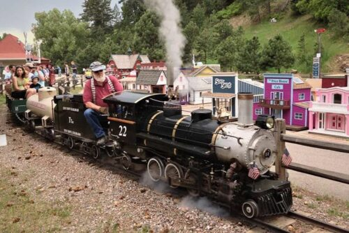 Tiny Town just outside out Denver is a miniature village with full operating steam locomotives that circle the dozens of little houses of this tiny village on a mile long track. Rich Grant photos.