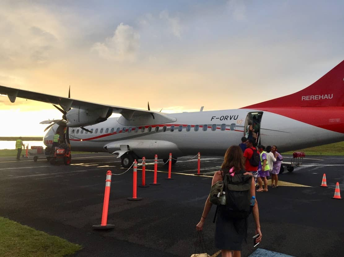Boarding a Tahitian plane bound for Raiatea after a quick stopover on Bora Bora. Pro tip: sit on the left side of the aisle for stunning views of the lagoon.