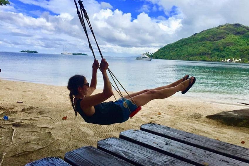 Michelle swinging after lunch on Taha'a, Tahiti. Aaron Pribble photos.