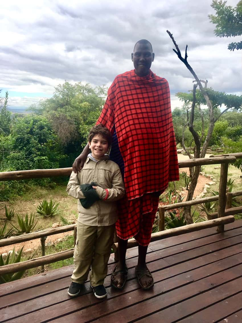 """My son with """"Lucky"""" from the Tarangire Treetops Hotel."""