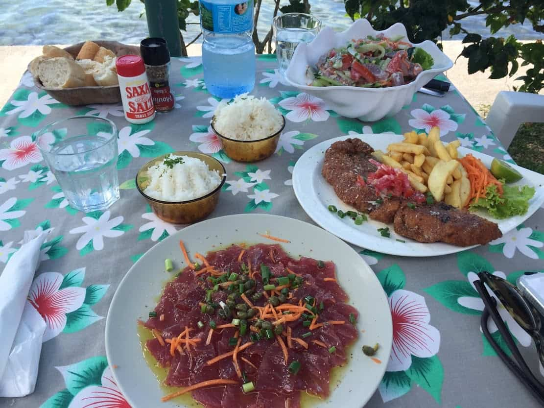 Lunch at Snack Mahana on Moorea. Tuna carpaccio, breaded local catch, and poisson cru.