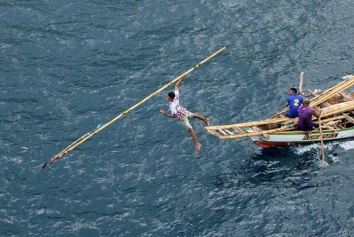 Whale hunting demonstration off Lamalera, Indonesia.