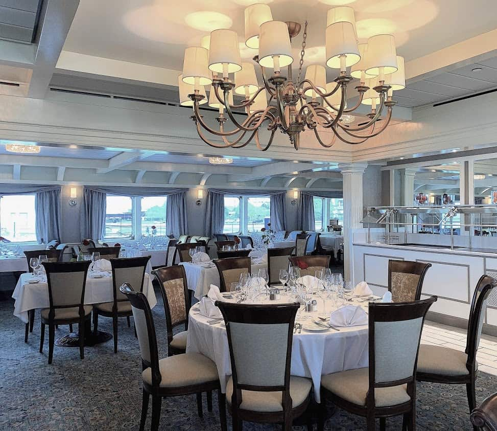 The dining room is light and airy with many windows for cruise views.
