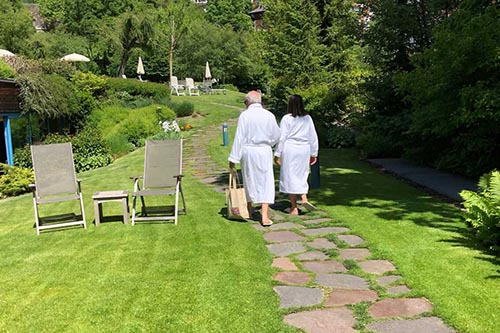 Bathrobes are the normal attire in the garden near the pool at Adler Dolomite Resort and Spa.