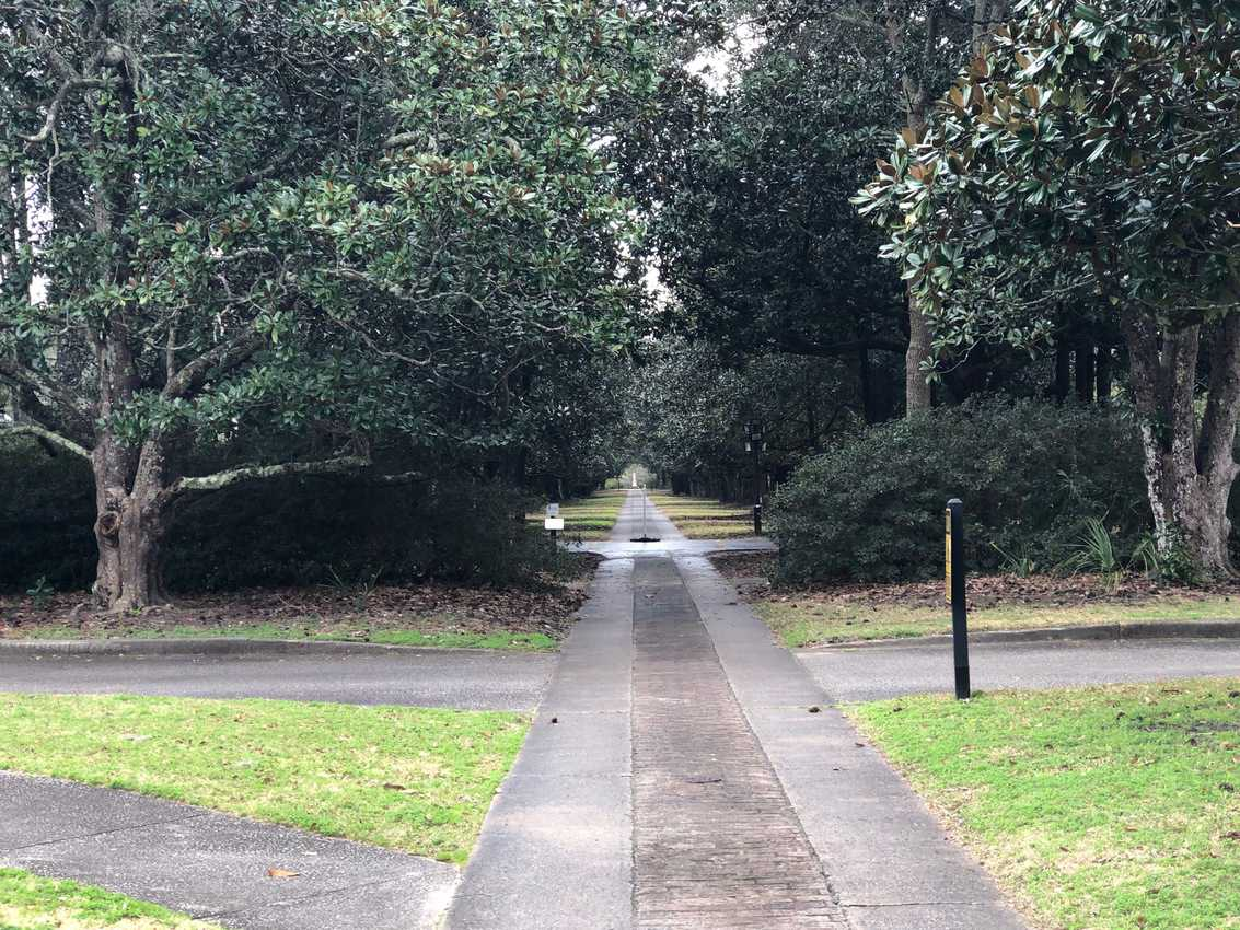 Pathways like this allow visitors to tour the property and enjoy the thousands of sculpture pieces.