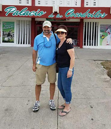 Jay Smith and a traveler in front of one of Cuba's baseball stadiums on a Sports Travel and Tours trip to the island in 2016.