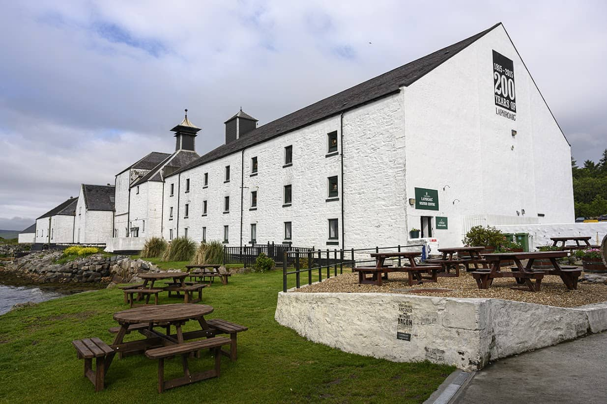 The patio outside the Laphroaig distillery's visitor's center invites visitors from around the globe to pause for a wee dram, or two.