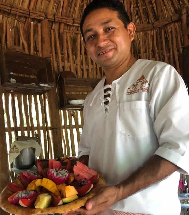 Breakfast in Uxmal in an ancient Mayan kitchen. Basket is filled with local, seasonal fruits.