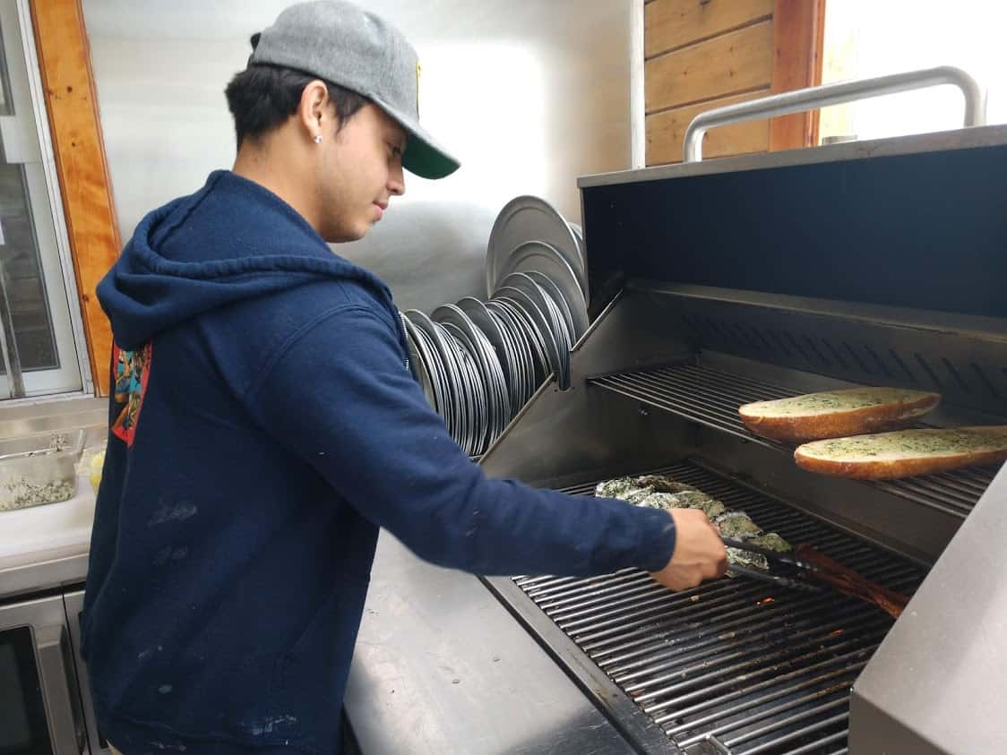 An employees grilling oysters at Marshall's Store in Tomales Bay.