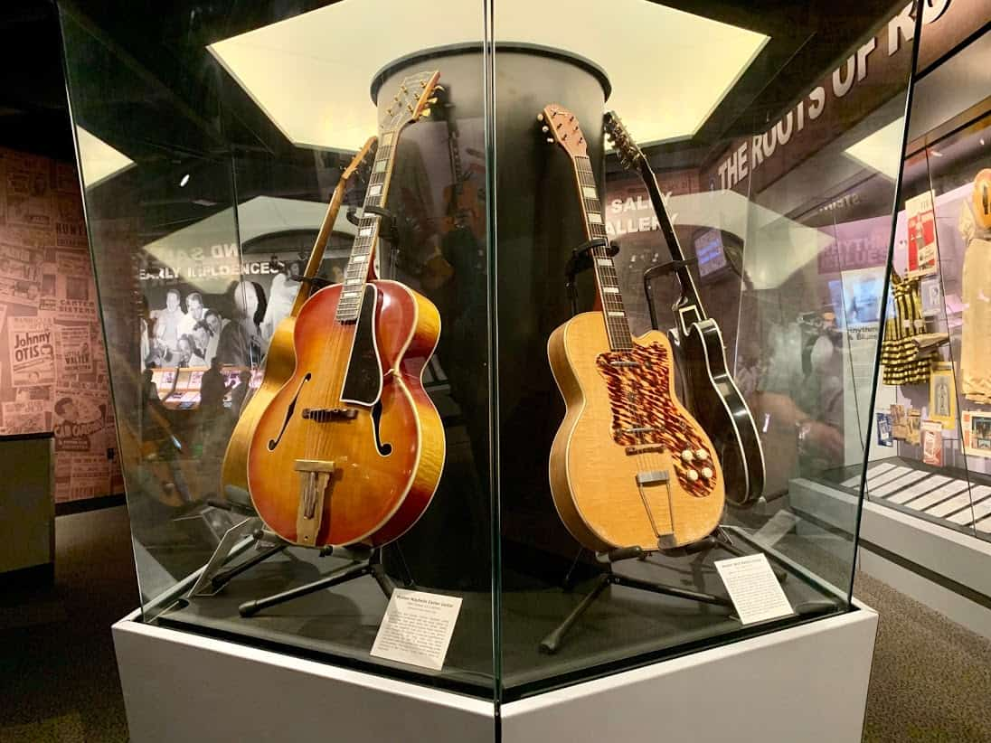 Guitars used by music legends are displayed in the Rock and Roll Hall of Fame museum.