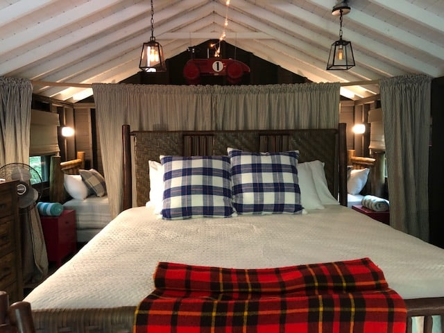 Some of the modern safari-style cabins at Sandy Pines feature beds for kids behind the main bed. Perfect for family camping.