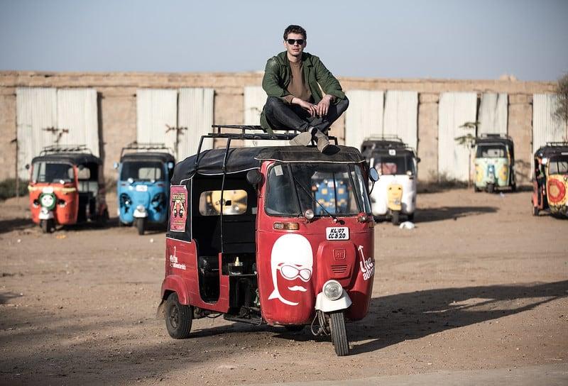 Mr. Tom, founder of The Adventurists, sitting atop a rickshaw