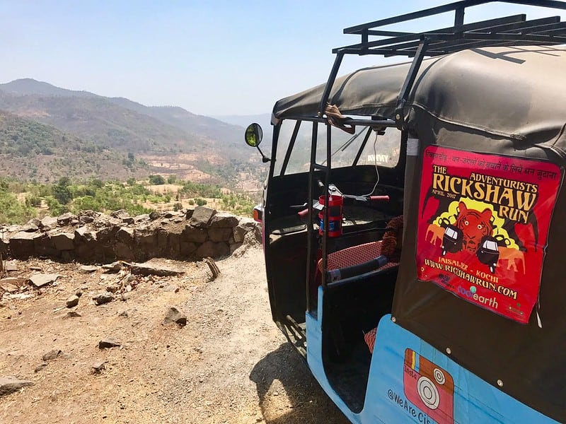 A rickshaw looking out into the Indian wilderness during the Rickshaw Run India