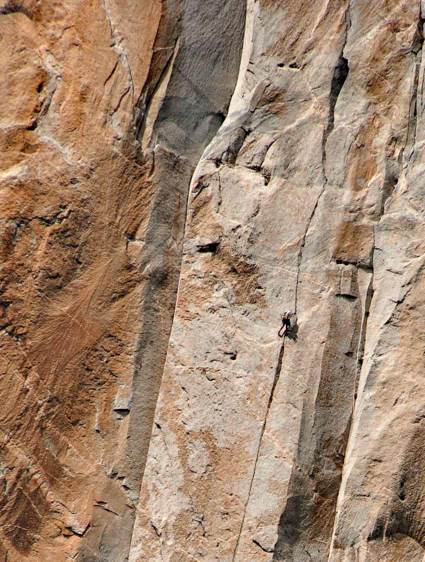 A rock climber makes his way along the face of El Capitan.
