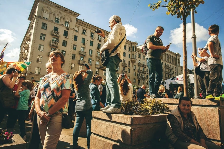 Onlookers watch a tightrope walker in Moscow.