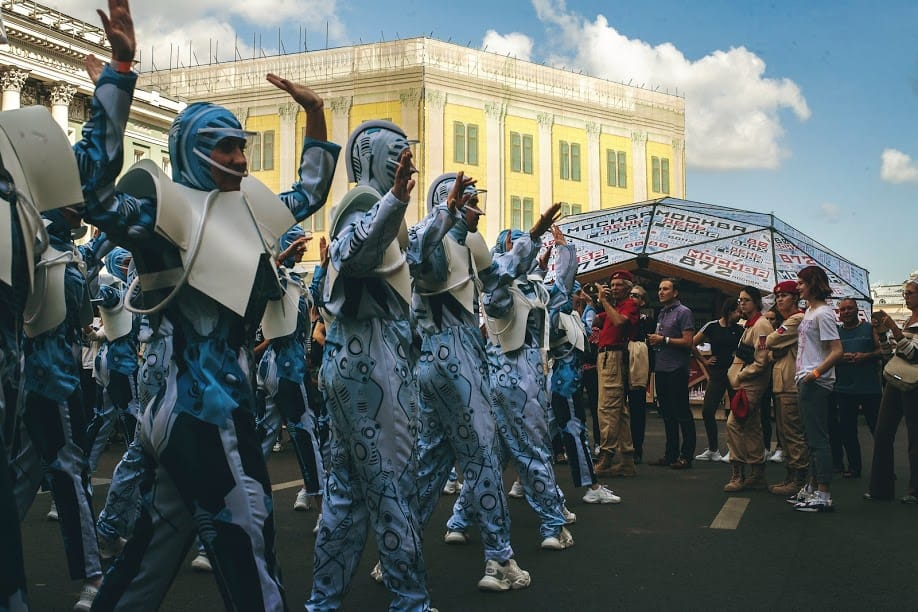 A dance troupe dressed as robots performs at Moscow City Day.