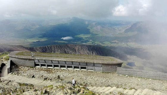 At the summit of Snowdon with a shot of its visitor centre amongst the Snowdonia grandeur.