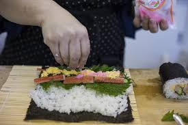 Rolling a sushi roll in Japan.