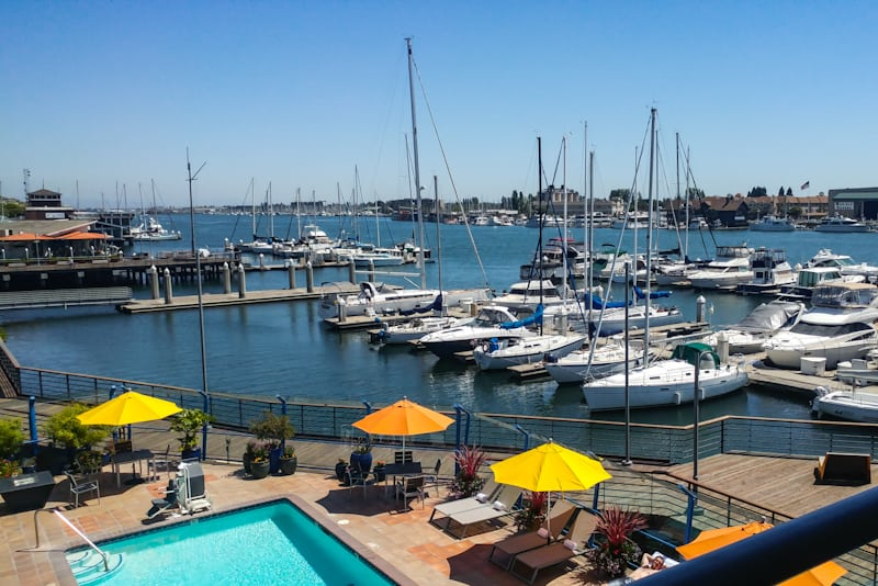 Sweeping views including the famed marina Waterfront Hotel, which features the ferry across the Bay just steps away.
