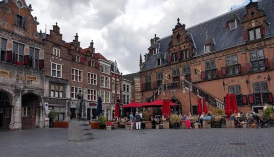 The town center in Nijmegen has buildings that date back to the 16th century, such as De Wagg, right, a popular restaurant where tables outside are the best seats in the house on a nice evening.