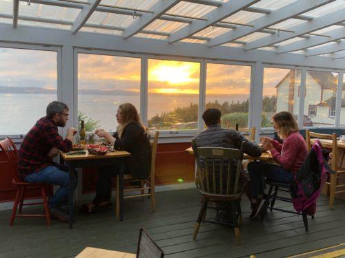 Dining by sunset out of the garden at the Bonavista Social Club, Bonavista Peninsula Newfoundland and Labrador.