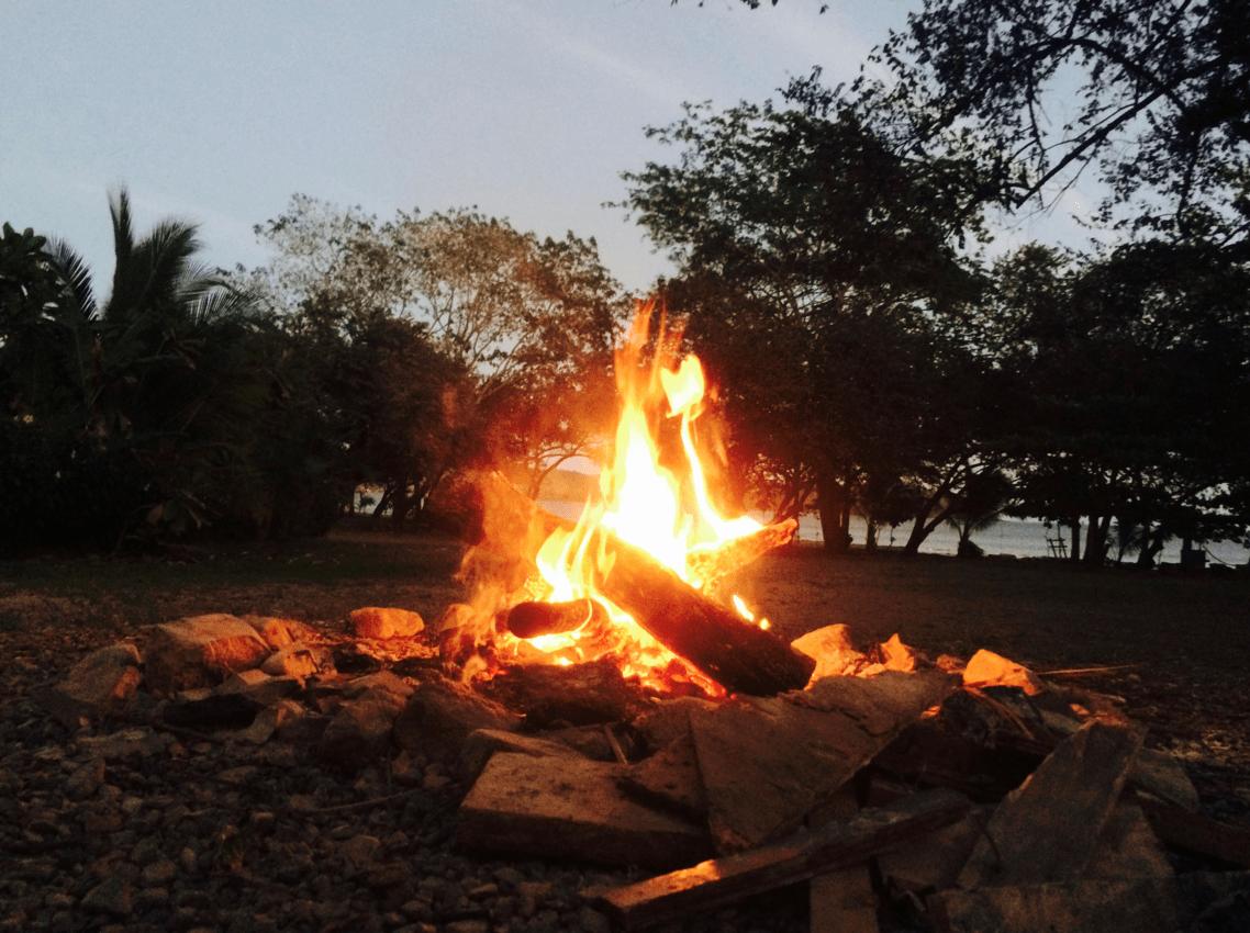 An evening bonfire at Hostel Venao Cove