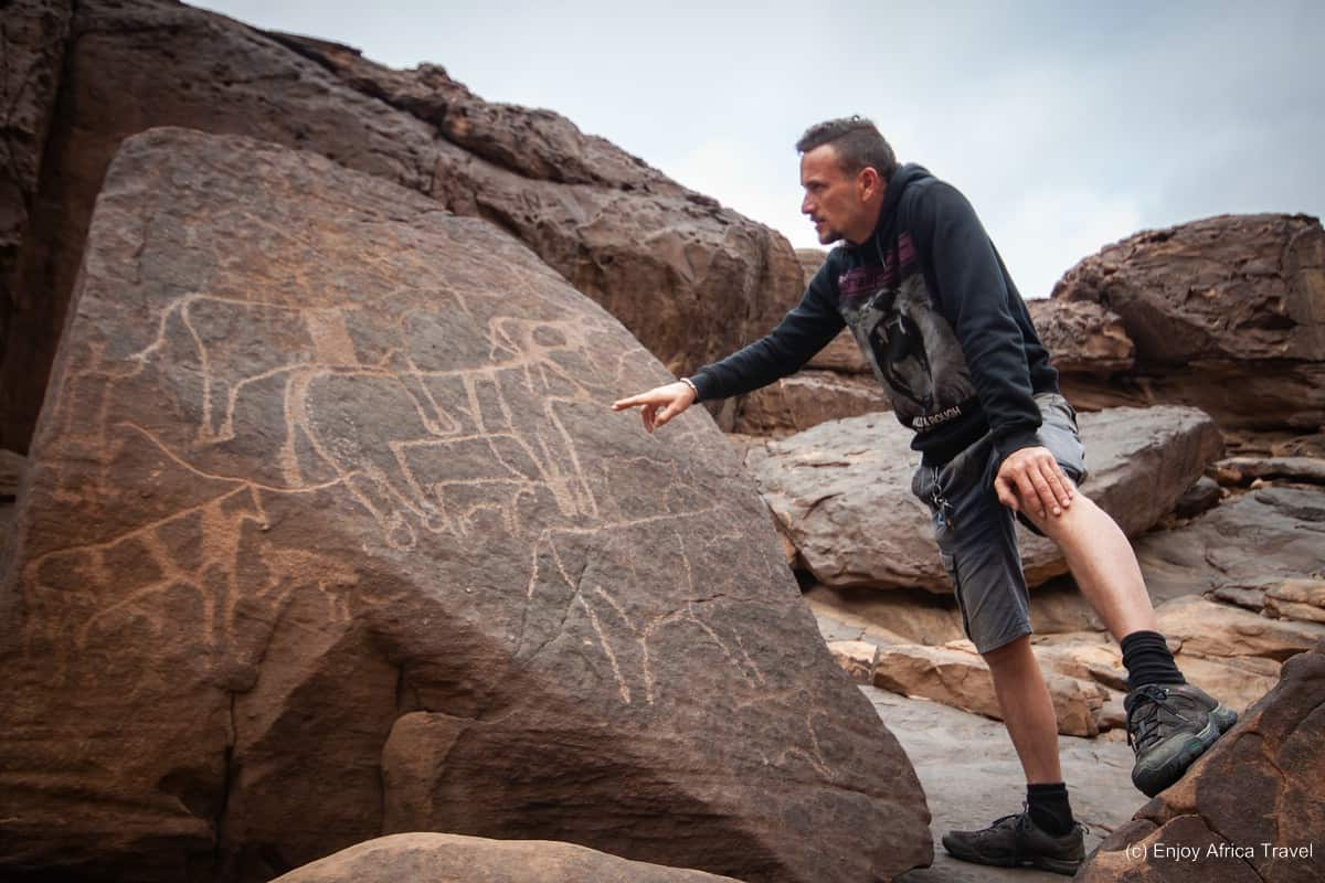 Rene trying to decipher more of these thousands of years old petroglyphs