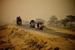 Rickshaws on a sandy road