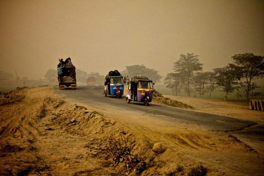 Rickshaws on a sandy road