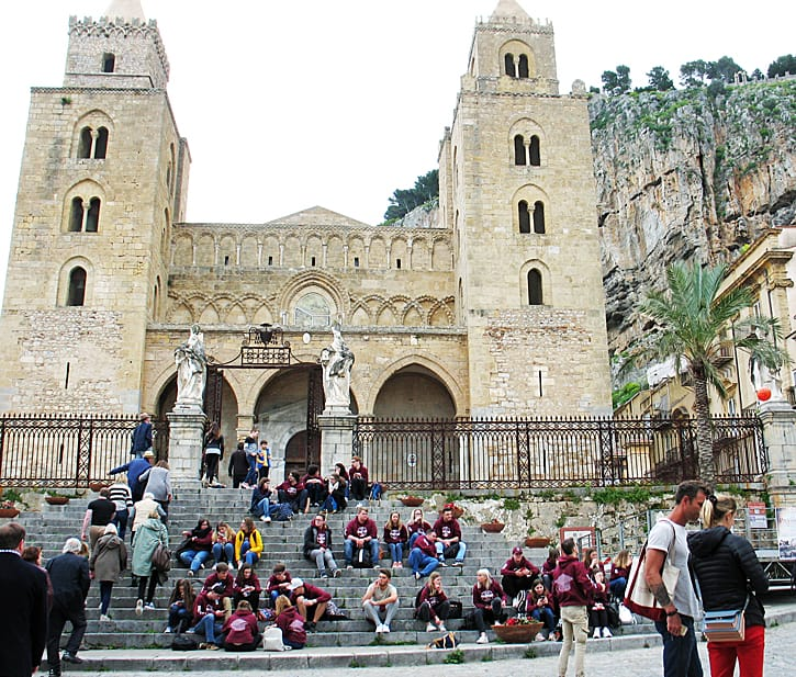 A school group rests after their tour of the cathedral in Cefalù, Sicily. (Photo by Susan McKee)