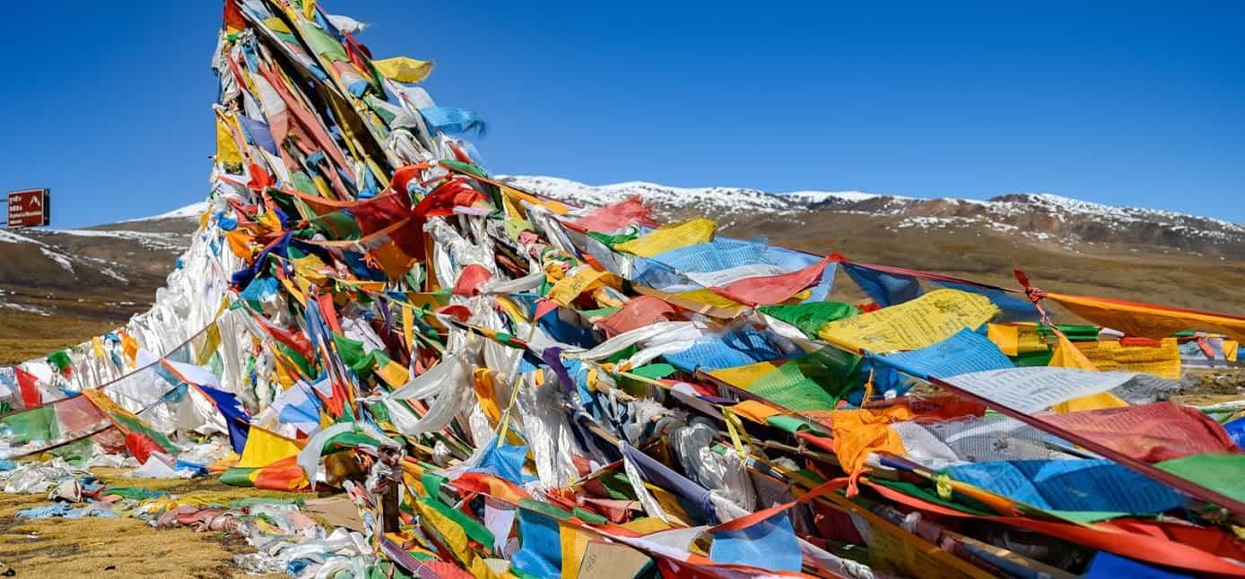 The Friendship Highway crosses over three mountain passes, all of which are marked with thousands of prayer flags left by travelers seeking a blessing from the Gods.