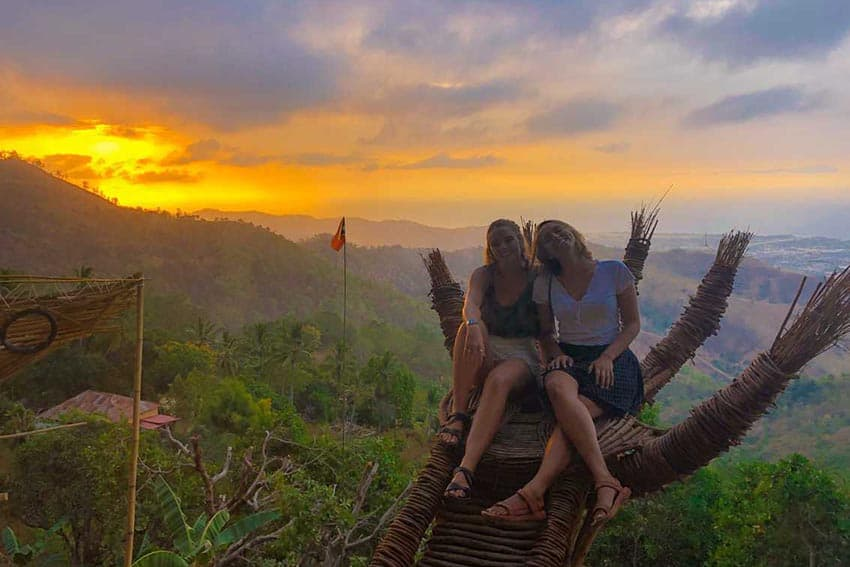 The author and a friend atop a mountain in Timor-Lest