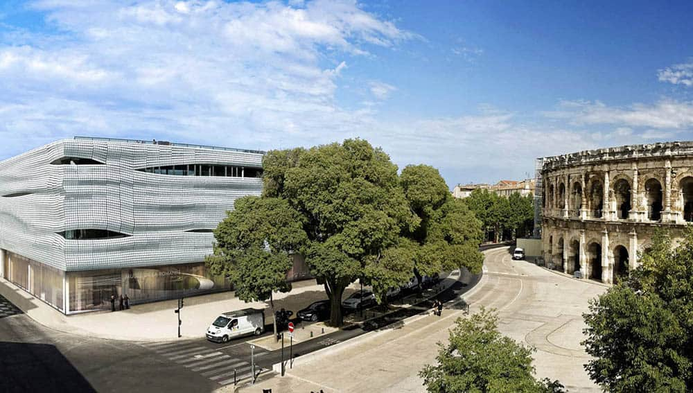MGP - PACO - Musée de la Romanité. The new eye-catching museum is next door to the 2,000-year-old arena regarded as the world's best-preserved amphitheater, modeled on the Colosseum in Rome.