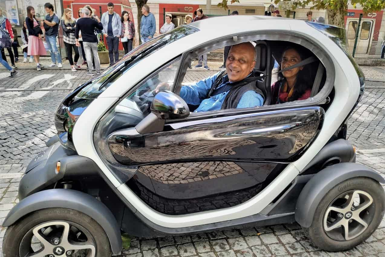 Exploring Sintra with my wife, Nirmala, in an electric vehicle