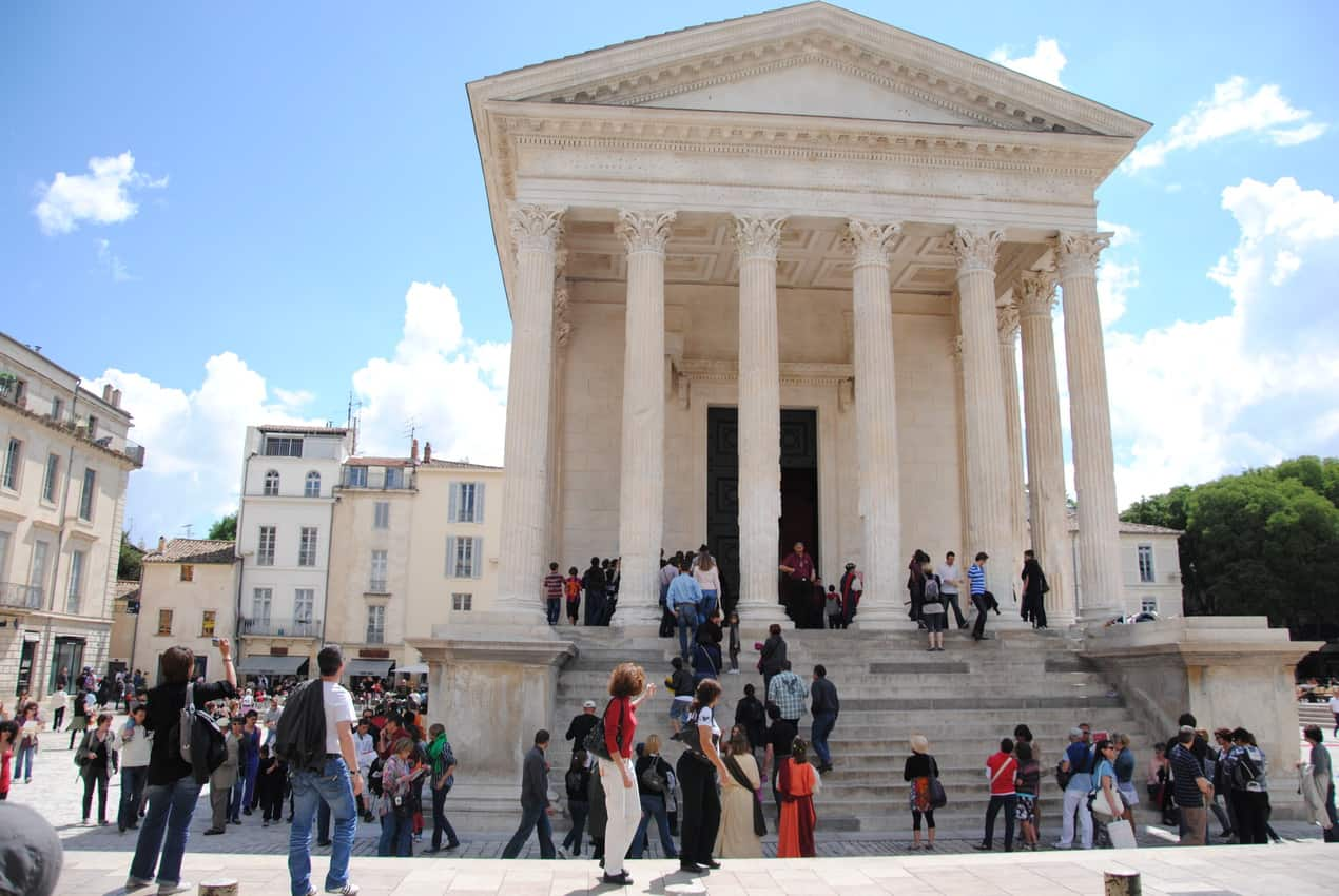 The Maison CarrÇe is a former forum and ancient surviving structure of Roman civilisation in a busy square in Nimes.