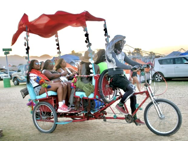The driver of a two-seater Day of the Dead-looking rickshaw, wears a skeleton bandana as he shuttles guests to and from the venue at Coachella Valley Music and Arts Festival in Indio. (Photo by Mindy Schauer, Orange County Register/SCNG)