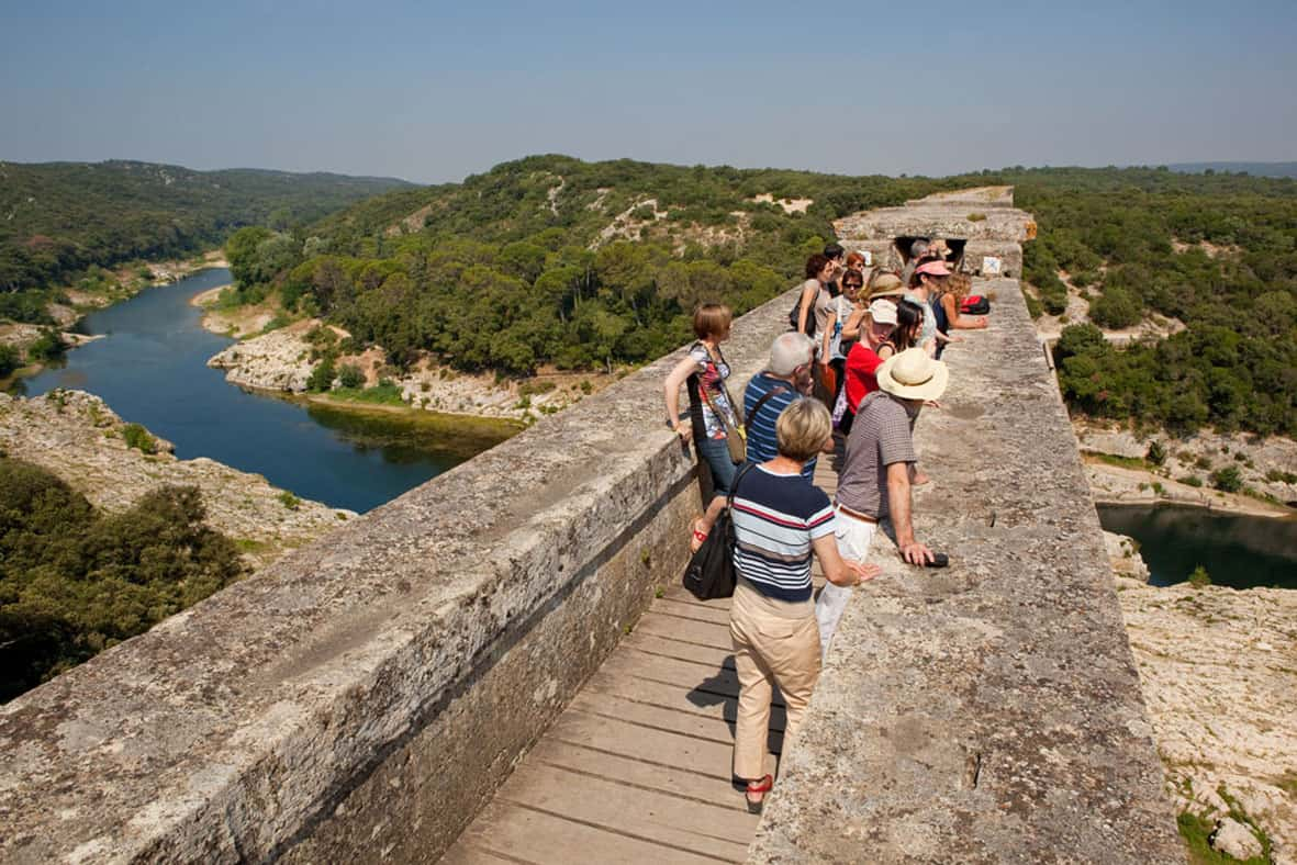 Tourists on top of the Roman aqueduct at Pont du Gard near Nimes.