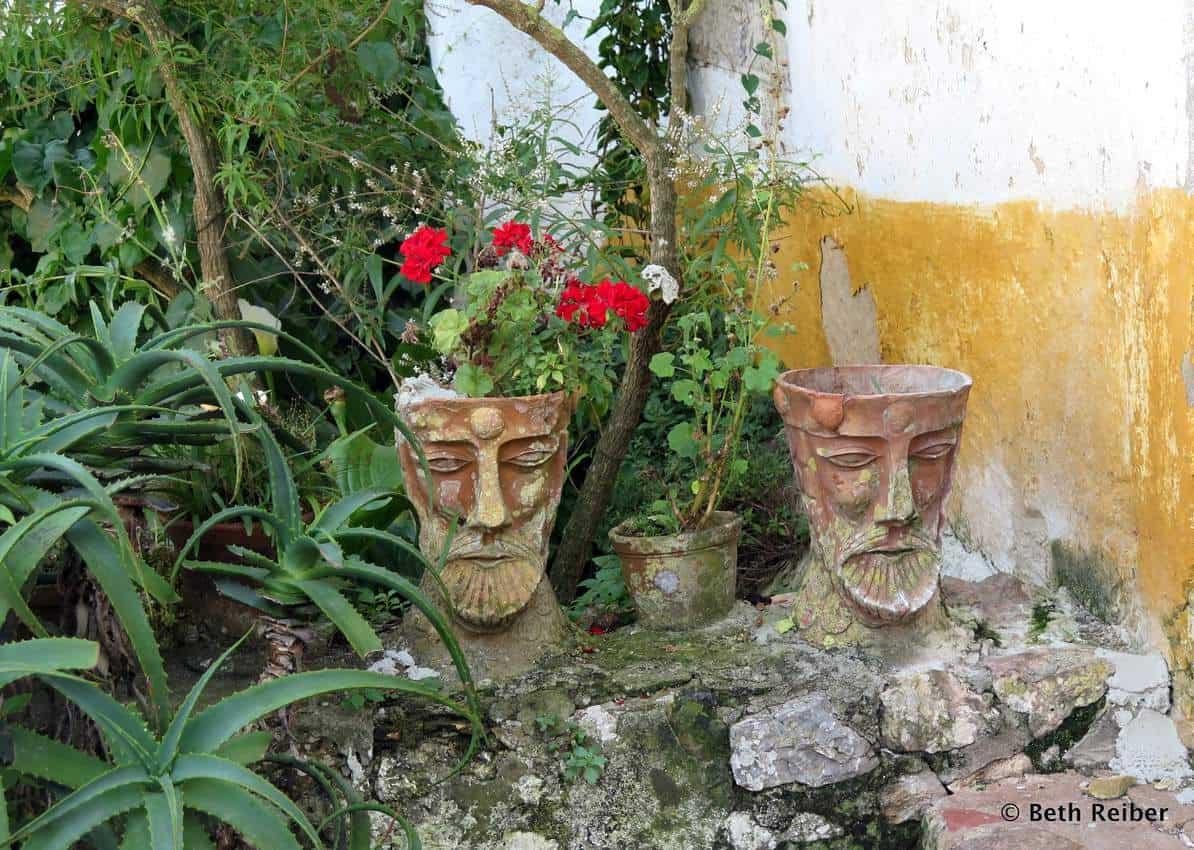 Unusual pots outside a private garden in Obidos Portugal