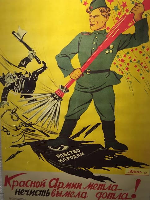 A Soviet propaganda poster showing the Nazis being swept out