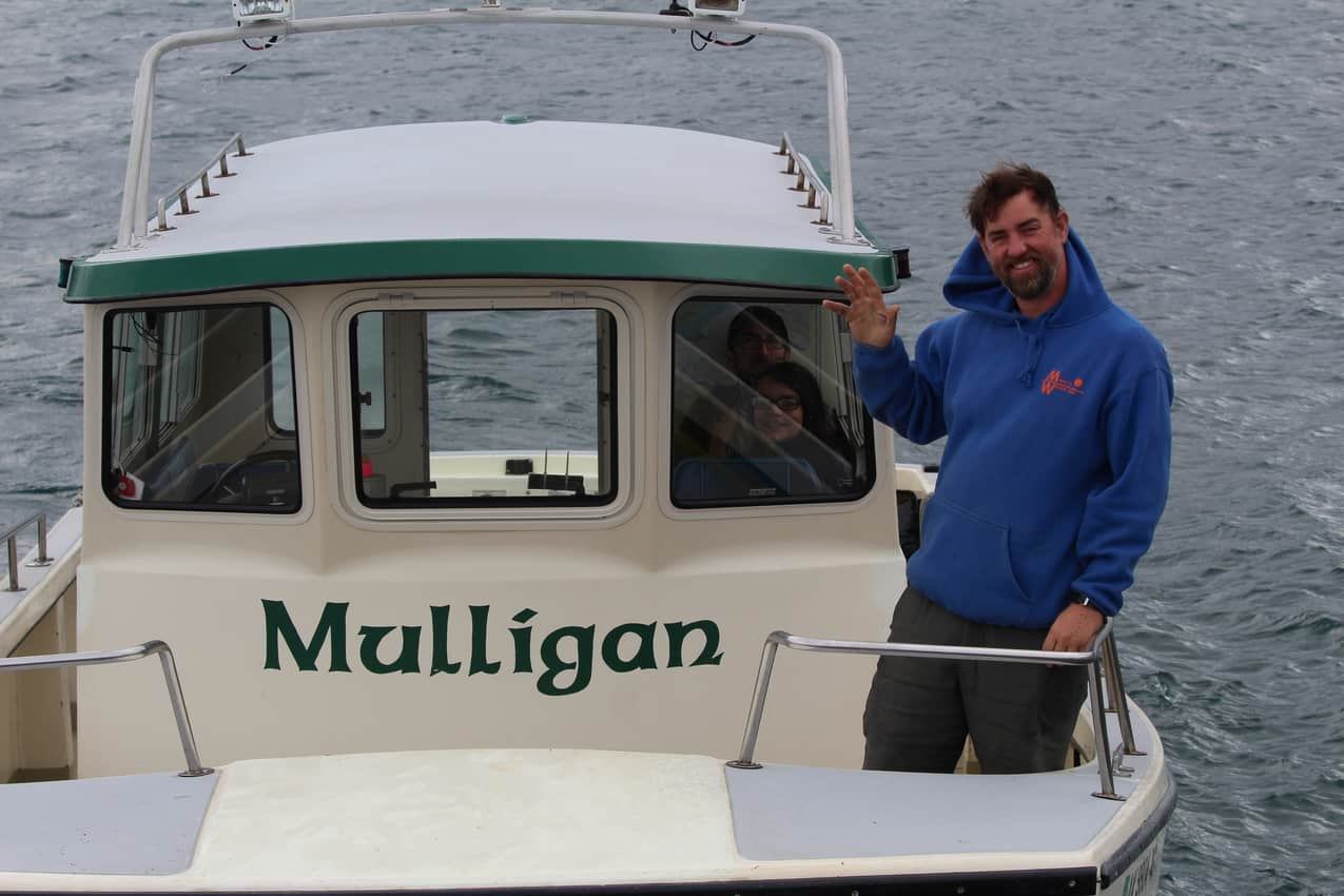 Capt. Lance of Mako's Water Taxi waves us aboard on Kachemak Bay.