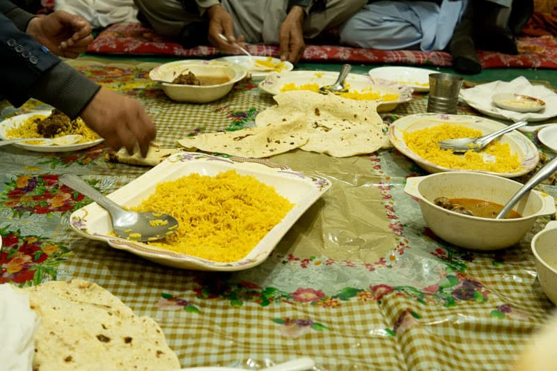 A feast of ox curry, biryani and chapati is enjoyed at a local wedding.
