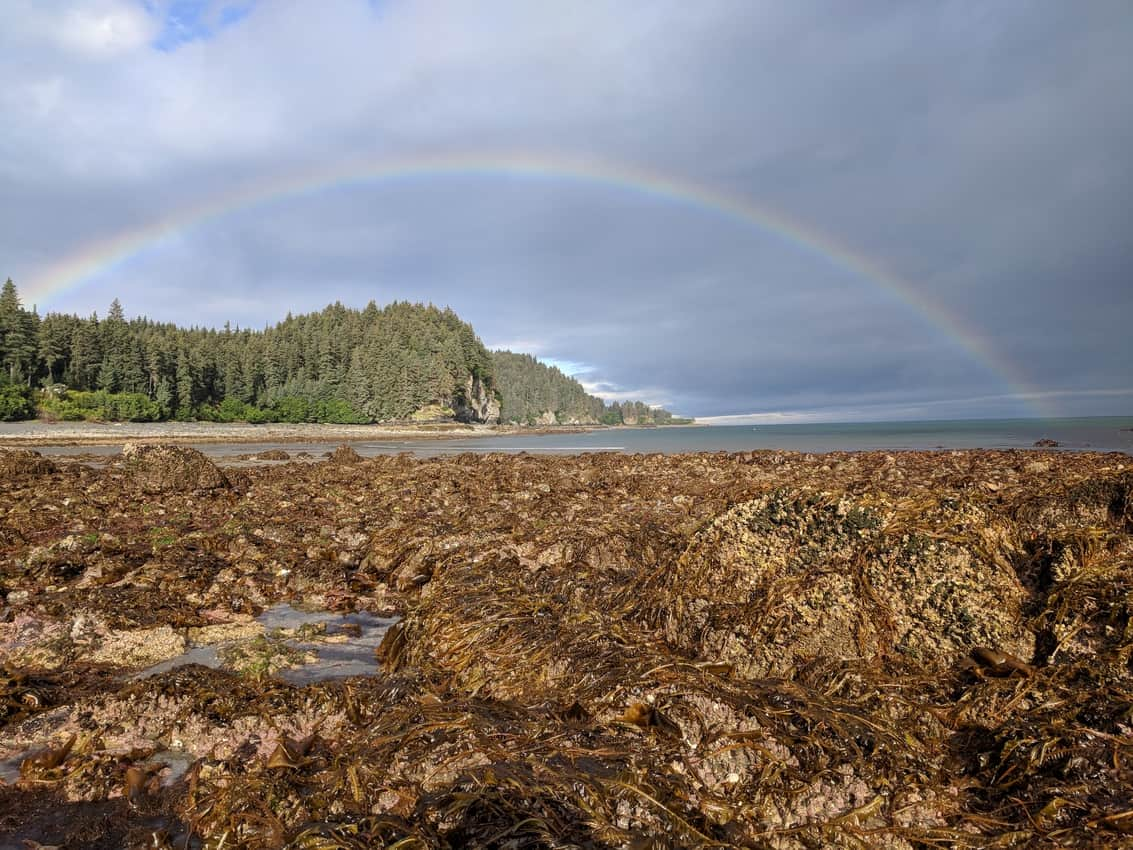 MacDonald Spit rainbow over the beach. Between Beaches